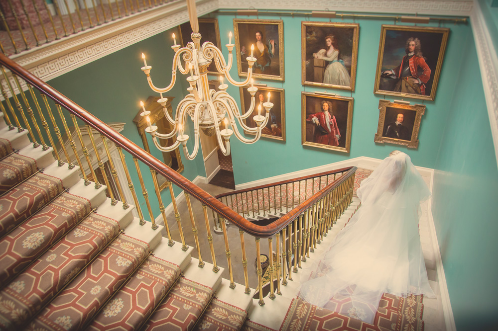 A bride walking down the stairs at Ballyfin Demesne