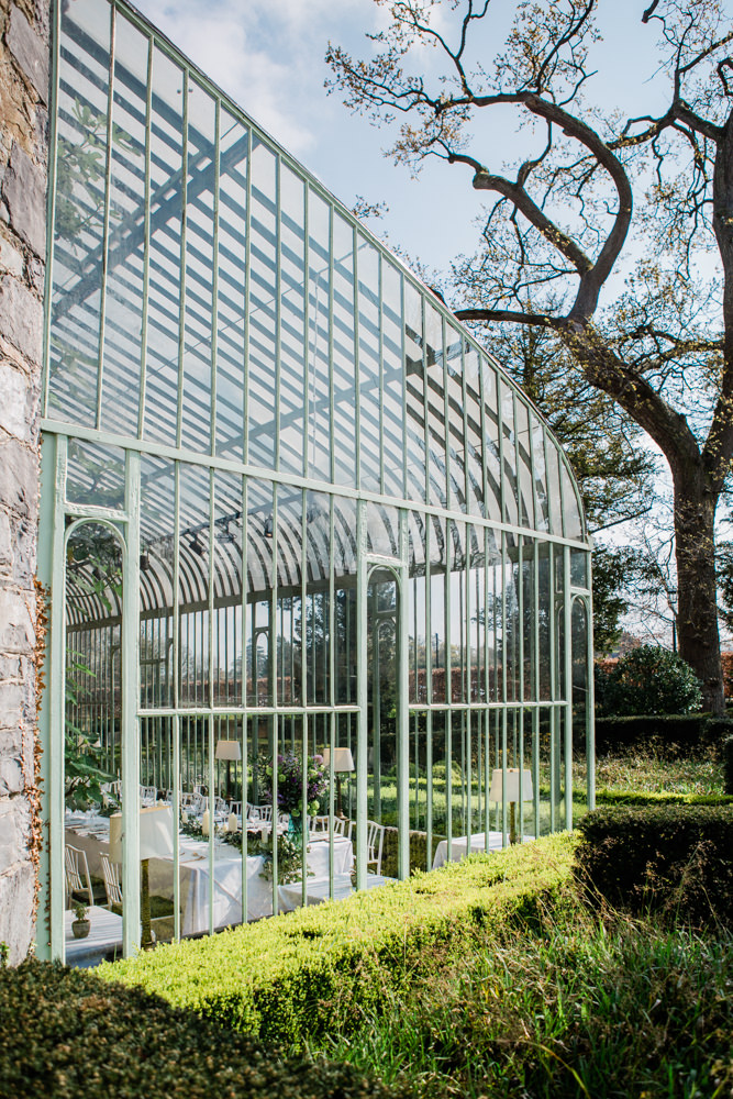 the orangery at cliifs at Lyons from the outside with beautiful wedding table setting insode